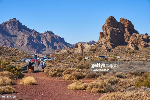 Tourists and locals on buses and rental cars visit the mountain volcanic nature reserve around Pico del Teide volcanic mountain on January 17, 2018...