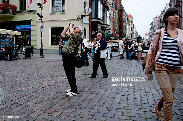 CONTENT] Tourists and locals on the streets of Torun in Poland at the end of summer