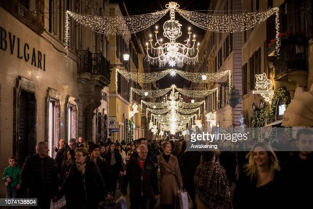 Tourists and locals shop under Christmas lights in via dei Condotti near the Spanish Steps on December 16 2018 in Rome Italy
