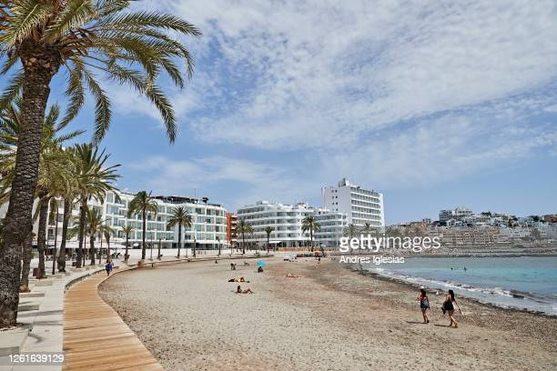 Tourists and locals sunbathe on Figueretas beach on July 28 2020 in Ibiza Spain The United Kingdom whose citizens comprise the largest share of...