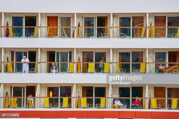 Tourists and locals visit the harbor and ferry terminal with the AIDA sol cruise ship on January 13 2018 in Santa Cruz de Tenerife Tenerife Spain