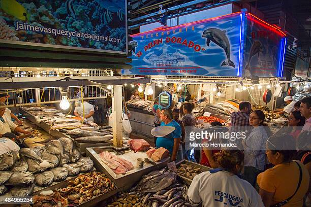 Tourists and locals walk around the Santiago Central Market on February 28th 2015 in Santiago de Chile Chile The Central Market is a traditional spot...
