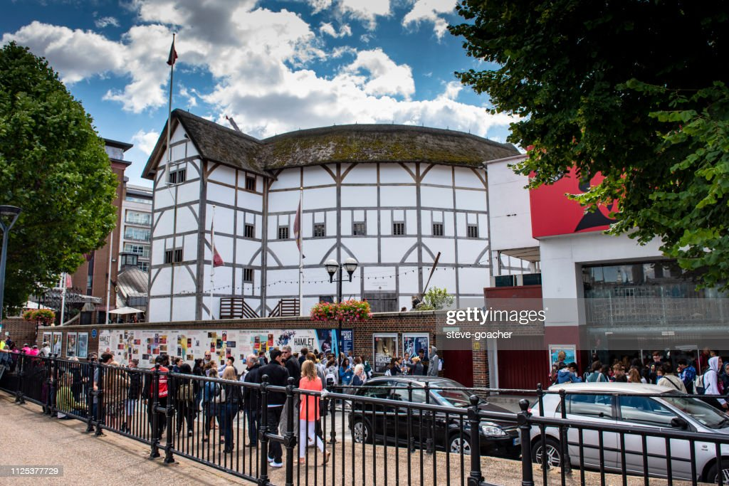 Tourists and locals walking beside Shakespeare's Globe theatre in London, England. : Stock Photo