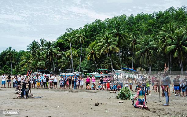 Tourists and locals watch an artistic performance during the 8th Annual Whale and Dolphin Festival at Bahia Ballena Beach in Puntarenas about 230 km...