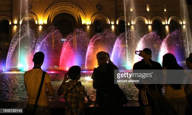 Tourists and locals watch the water show in a fountain on the square of the republic in Jerewan Armenia 29 June 2106 The German foreign minister...