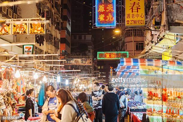 Tourists and market stalls at Temple street night market, Hong Kong, China