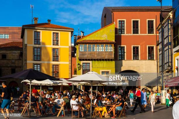 Tourists and neighbors on the terraces of the bars of the historic center at sunset,as seen July 15, 2019 in Gijon, Asturias, Spain.