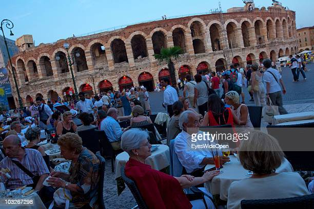 Tourists and operagoers are sitting in restaurants at Piazza Bra in front of the Arena di Verona on July 14 2010 in Verona Italy Verona is famous for...