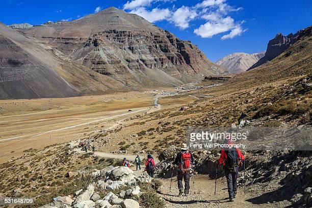 tourists and pilgrims doing kora around mt kailash - mt kailash stock pictures, royalty-free photos & images