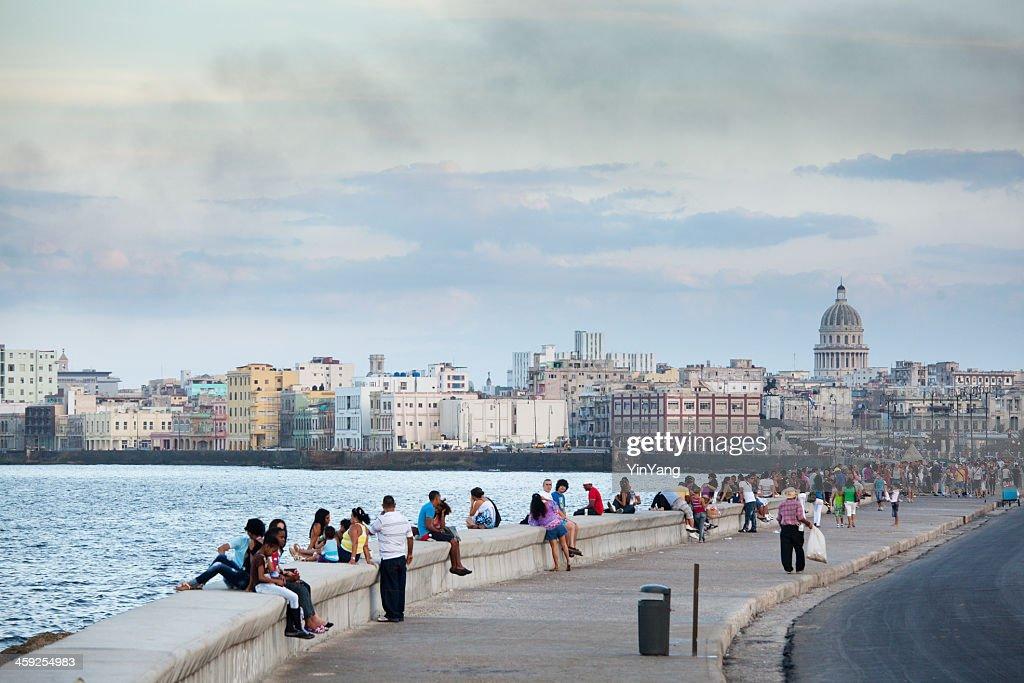 Tourists and Residents Enjoying the Malecón of Havana Cuba : Stock Photo