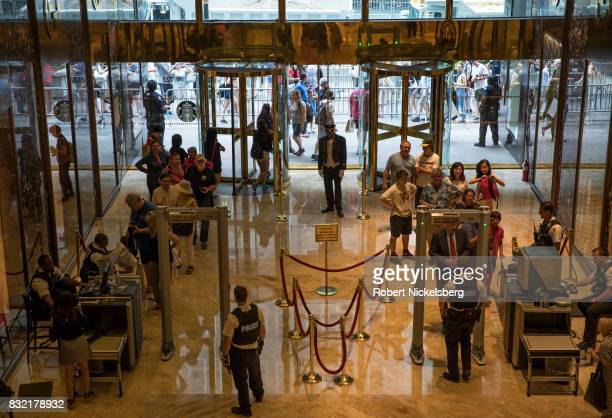 Tourists and shoppers clear Secret Service security before entering Trump Tower August 14 2017 in New York City Security throughout the area is high...