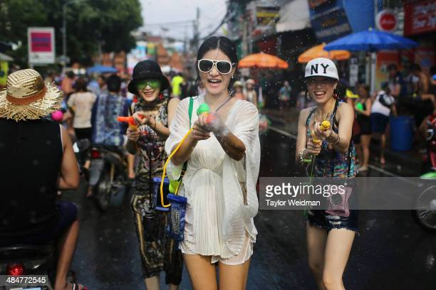 Tourists and Thai residents take part in a citywide water fight during the Songkran water festival on April 14 2014 in Chiang Mai Thailand The...