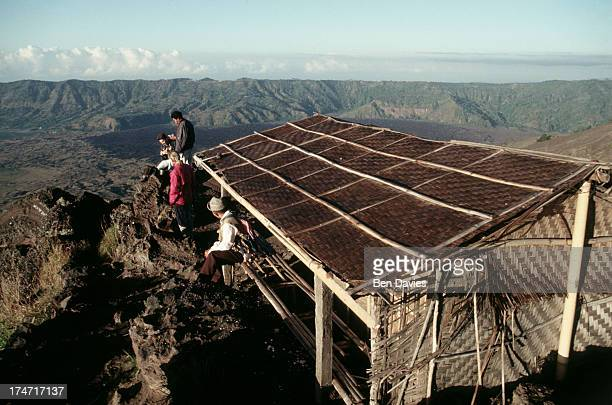 BATUR PENELOKAN BALI INDONESIA Tourists and their guide on the top of Gunung Batur in Bali Indonesia witness a spectacular sun rise Mount Batur is...