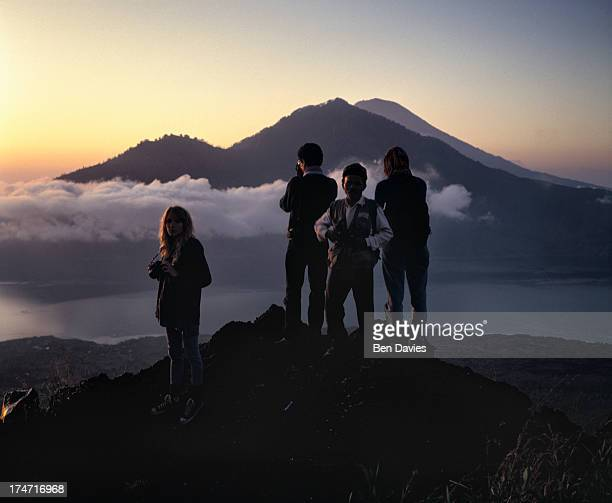 Tourists and their guide on the top of Gunung Batur on the Indonesian island of Bali witness a spectacular sunrise Mount Batur is the fourth highest...