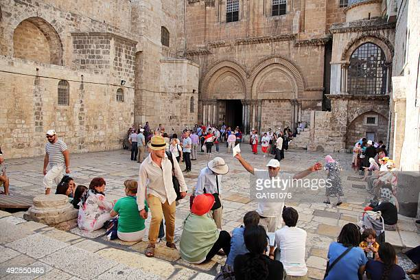 Tourists and tour guide at Church of the Holy Sepulchre