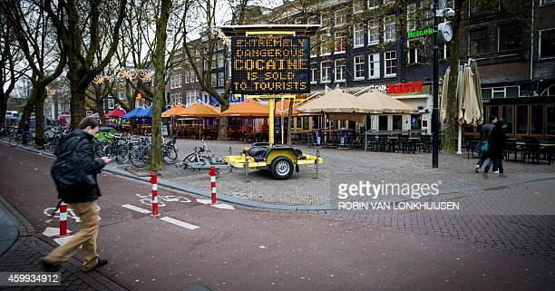 Tourists are being warned with an electronic board message for snorting white heroin that is sold to them as cocaine at Thorbeckeplein in Amsterdam...