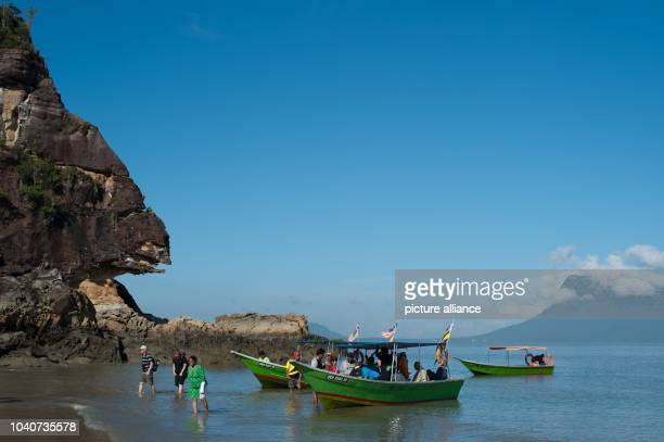 Tourists are departing a boat on the shore of the South China Sea at the Bako National Park near Kuching Malaysia 25 October 2014 Photo Sebastian...
