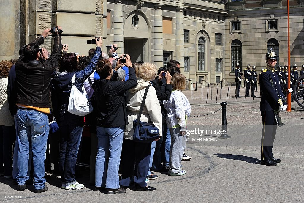Tourists are eager to take pictures as they wait for the changing of the guard in front of the Royal Castle in Stockholm on May 24, 2010. Many tourists paid a visit to the Swedish capital less than a month before Crown Princess Victoria 's wedding, the 32-year-old eldest daughter of King Carl XVI Gustaf.
