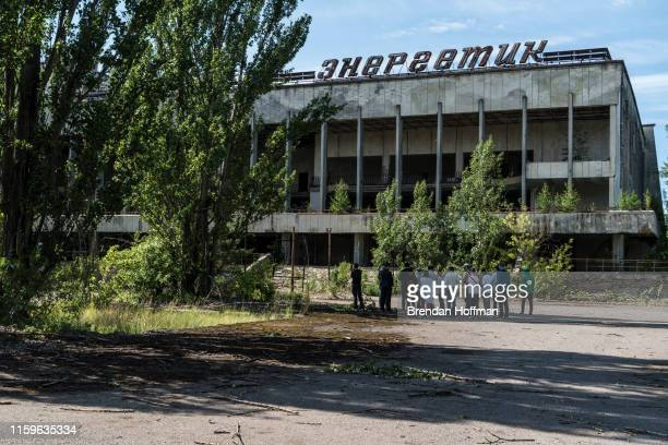 Tourists are guided around the abandoned city of Pripyat inside the Chernobyl Exclusion Zone on July 2 2019 in Pripyat Ukraine In November 2016 the...