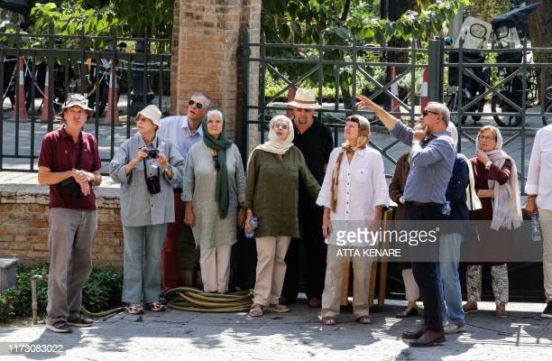 Tourists are guided as they visit Iran's National Museum in the capital Tehran on October 2 2019
