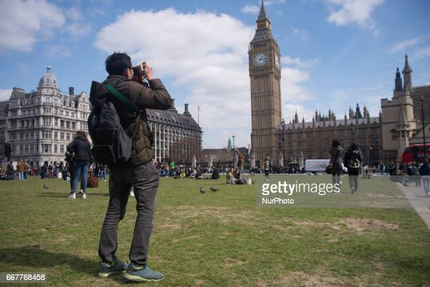 Tourists are picture while visit and queue for the monuments in Central London on April 12 2017 Thousands of tourists went for a visit at places as...