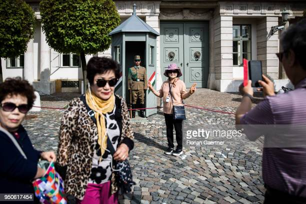 Tourists are pictured in front of the Sandor Palais on April 14 2018 in Budapest Hungary