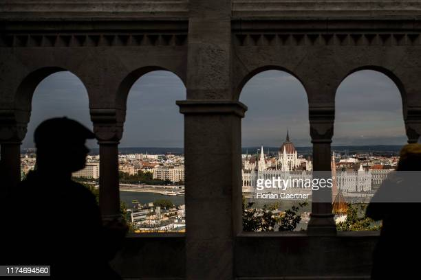 Tourists are pictured on the Halaszbastya with view to the Orszaghaz on October 03 2019 in Budapest Hungary