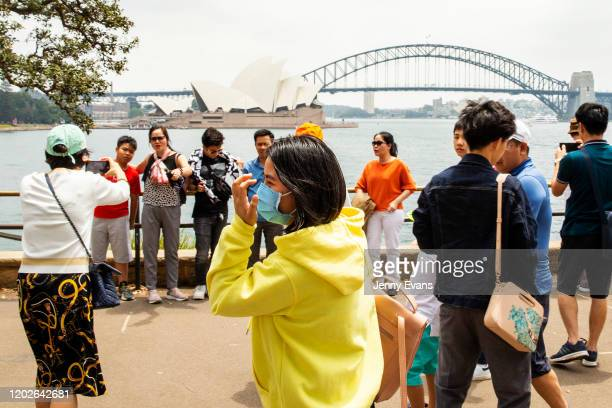 Tourists are seen at Mrs Macquarie's Chair on January 29, 2020 in Sydney, Australia. The coronavirus, which originated in Wuhan, China, has now...