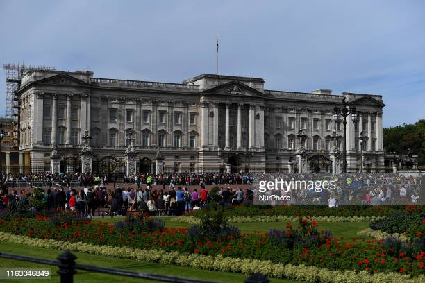 Tourists are seen at St Jamess Park and outside Buckingham Palace in London on August 21 2019