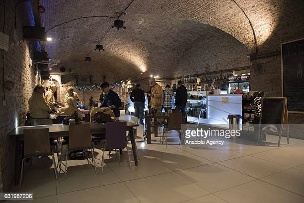 Tourists are seen at the deepest pub in Europe located at 322m below sea level after visiting the deepest historic coal mine in Europe, called Guido...