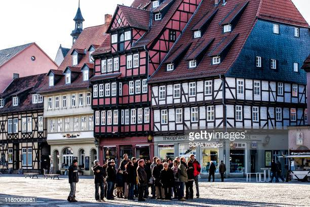 Tourists are seen at the Market Square at the historic center of Quedlinburg an Unesco World Heritage Site in Quedlinburg