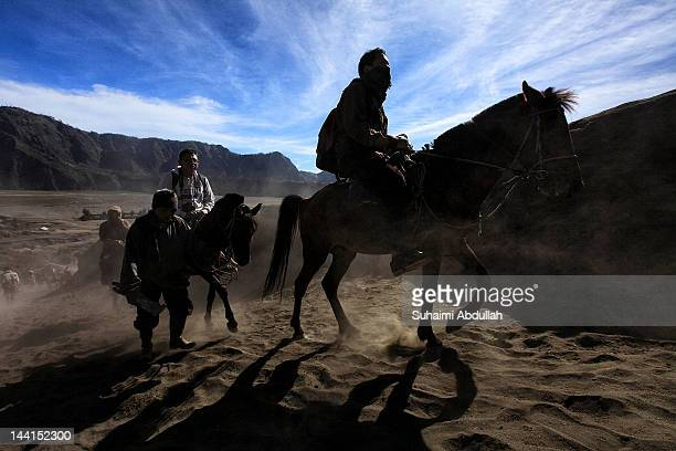 Tourists are seen making their way to the foot of Mount Bromo caldera on horses on April 12 2012 in Java Indonesia