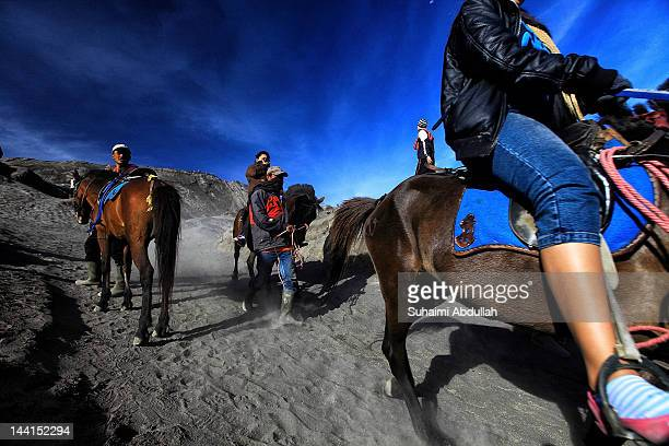 Tourists are seen making their way to the foot of Mount Bromo on horses on April 12 2012 in Java Indonesia