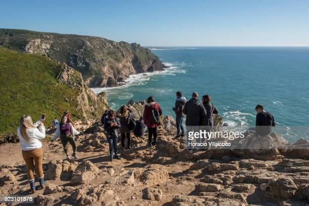 Tourists are seen on a sunny winter afternoon in Cabo da Roca on February 22 2018 in Sintra Portugal Cabo da Roca is a cape which forms the...