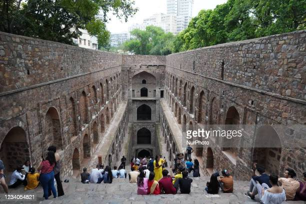 Tourists are seen on the steps of the Ugrasen Ki Baoli- a traditional stepwell in New Delhi, India on July 18, 2021. Baoli's are traditional water...