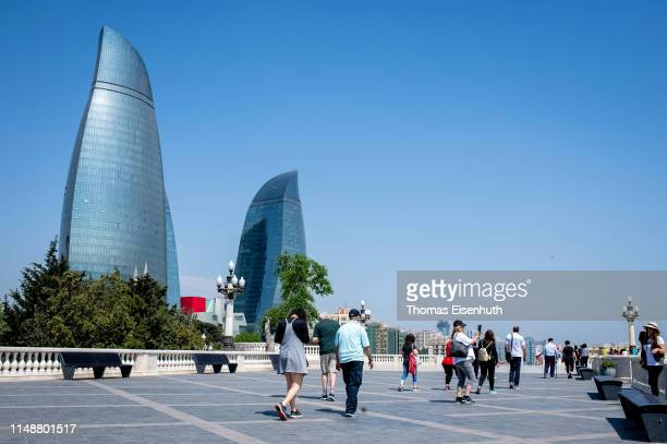 Tourists are seen on the top of the Nagorny Park on May 13, 2019 in Baku, Azerbaijan.