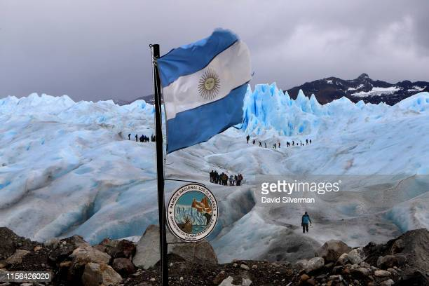 Tourists are seen on twohour trek on the Perito Moreno glacier a part of the Southern Patagonian Ice Field on April 5 2019 in the Los Glaciares...