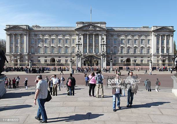 Tourists are seen outside Buckingham Palace in London UK on Thursday April 7 2011 The wedding of Prince William second in line to the British throne...