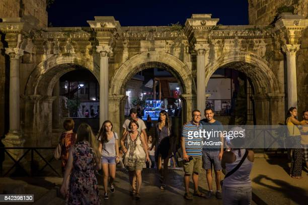 Tourists are seen visiting Hadrian's Gate on September 2 2017 in Antalya Turkey Turkey's tourism industry spiraled into crisis in 2016 after a year...