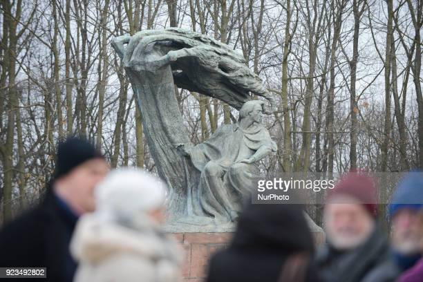 Tourists are seen visiting the Frederic Chopin monument in Lazienki park in Warsaw Poland on February 23 2018 The city is preparing activities for...