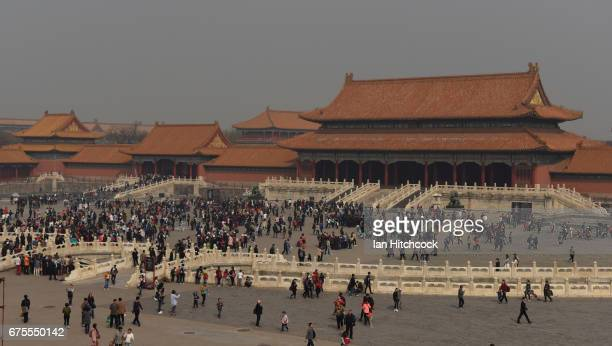Tourists are seen waking through the grounds at the Forbidden City on April 3 2017 in Beijing China