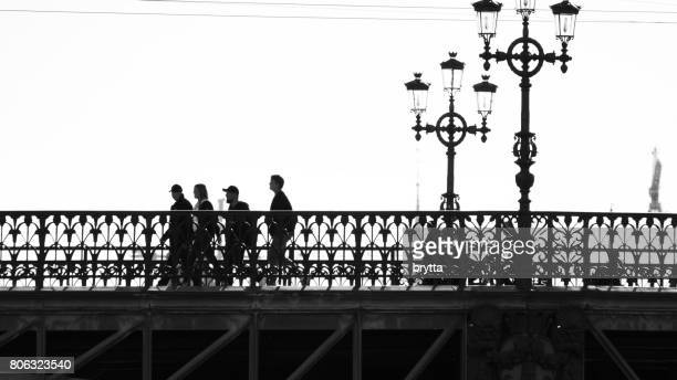 Tourists are walking over the Djurgarden Bridge ( Djurgardsbron ) in Central Stockholm,Sweden