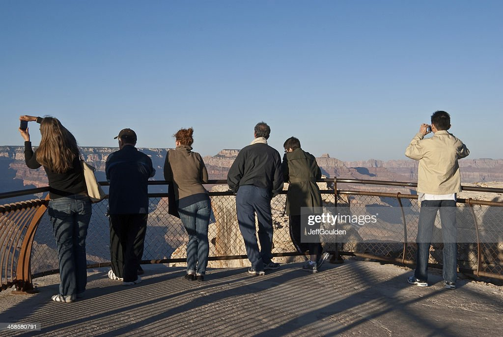 Tourists Watch the Sunset from Mather Point : Stock Photo