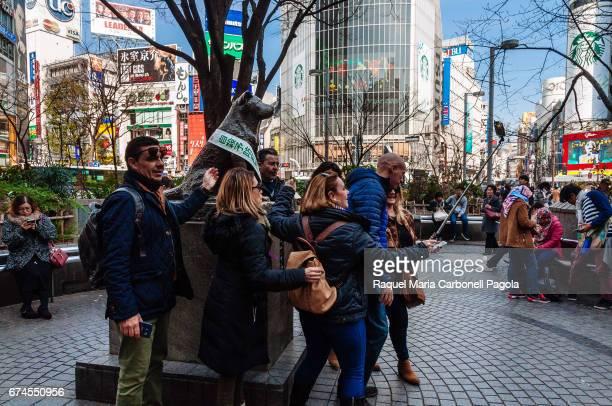 Tourists around Hachik dog bronze statue in Shibuya