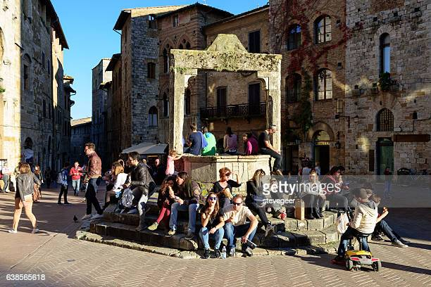 Tourists around Well in San Gimignano, Italy