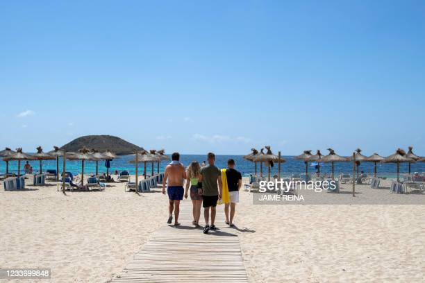 Tourists arrive at Magaluf Beach in Calvia, on the Balearic Island of Mallorca, on June 28, 2021. - British holidaymakers heading to the Balearic...