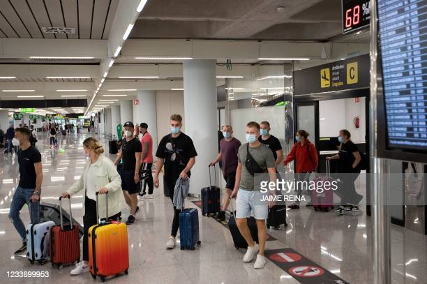 Tourists arrive at Son Sant Joan airport in Palma de Mallorca on June 28, 2021. - British holidaymakers heading to the Balearic Islands will need to...