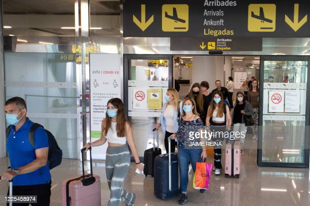 Tourists arrive at the Son Sant Joan airport in Palma de Mallorca on July 8, 2020. - The Balearic Islands are expecting a wave of tourists from the...