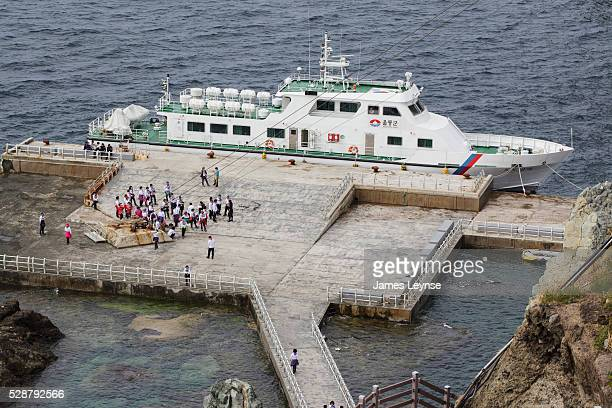 Tourists arrive by ferry on Dokdo island in Korea Dokdo is a disputed island off the eastern most end of Korea's territories and is located 874km to...