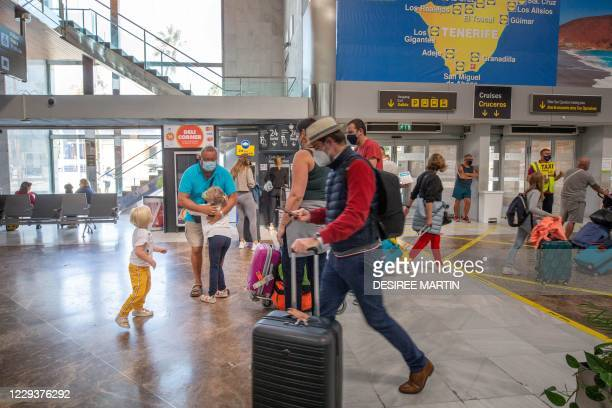 Tourists arrive from different European cities, especially from the United Kingdom and Germany, to the Reina Sofia Tenerife-South airport on the...